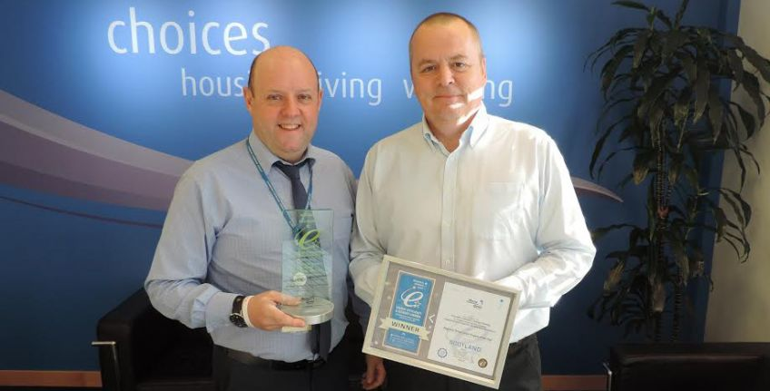 David Baptie, Senior Building Surveyor (Planned), Dunedin Canmore and George Donaldson, Managing Director, Insulation Solutions Scotland, celebrate with their award